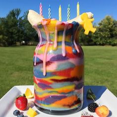 57 Layer Fruit Smoothie!!🍉🍌🍍🍓 TBT to this epic #smoothie from my last birthday that took me 2-3 days to drink😂😂🙌 It astonishes me all the colors nature provides!!🌈 You know mango man is having the time of his life in this picture since he had to climb up the rainbow smoothie mountain to get a taste of the pot of gold😂 Have a beautiful day! SMOOTHIE FLAVORS⤵️ Red: strawberries  Yellow: mango  Pink: dragonfruit  Black: blackberries  Maroon: blueberries  Green: kiwi, squeezed lime…
