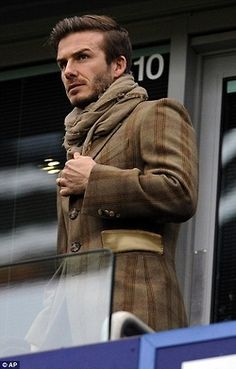Check out David Beckham's laid-back scarf style - looking exceptionally suave but could do with a print or two to liven up the outfit!  SHOP THE LOOK: http://shop.arteecollage.com/Men_s/1866.htm