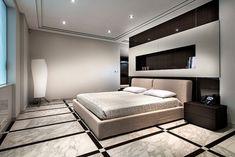 une chambre à coucher moderne avec un reveement de sol aspect marbre