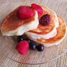 The Best Ricotta Pancakes---A Family Favorite! Light and tangy pancakes, perfect with fresh berries! Allrecipes.com