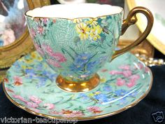 SHELLEY MELODY CHINTZ Victorianteacupshop TEA CUP AND SAUCER DEMITASSE