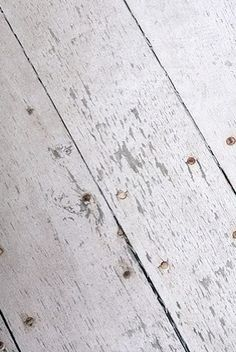 Love the look of distressed white-washed wood floors. Easy to do yourself too!