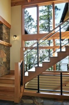 A little modern for my taste, but the wood and stone accents caught my eye
