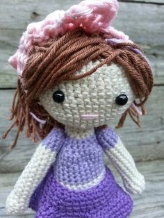 I crochet this amigurumi doll. I worked out a pattern for a doll and 2 outfit and 2 pairs of shoes.