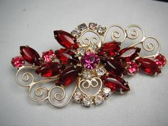 Vintage Estate Brooch- Beautiful Ruby Red and Pink Rinestone. Wear on your Purse, Scarf, or just admire the beauty of a by gone age.