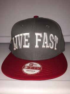 Live fast gray with red brim flash symbol on the side