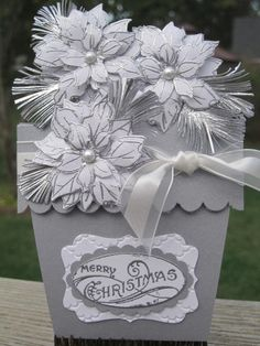 """Flower Pot Pocket --A tutorial can be found on Splitcoast Stampers for the Flower Pot Pocket Card,   Stamp Sets: More Merry Messages, Bells & Boughs, Watercolor Winter   Card Stock: Whisper White, Brushed Silver   Ink: Versa Mark   Decorative Label Punch, Large Oval Punch, Scallop Oval Punch, Scallop Trim Border Punch,   Silver embossing powder, 5/8"""" Organza Ribbon, Fancy Fan Folder, Frost White Shimmer Mist, White Pearls (non Stampin' Up!), dimensionals, tombow liquid glue"""