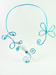 Necklace in wire wrapped aluminium feathers and beads by alufolie, $20.00