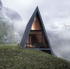 triangular house with a glass balcony is nestled into a CLIFF The unusual house is situated on the edge of a fictional cliff.The unusual house is situated on the edge of a fictional cliff. Nature Architecture, Architecture Design, Baroque Architecture, Architecture Facts, Computer Architecture, Russian Architecture, Architecture Student, Classical Architecture, Amazing Architecture