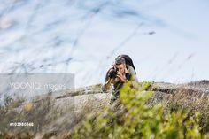 Yooniq images - Man Videotaping Landscape