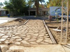 Use discarded concrete pieces to make a patio or walkway and stain them.  Will…