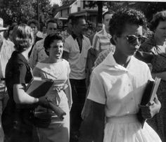Fifteen-year-old Elizabeth Eckford endures with dignity the jeers of a mob during the desegregation of Little Rock Central High School.    The look of venom on that mom's face… I rarely think that's a face that's captured.