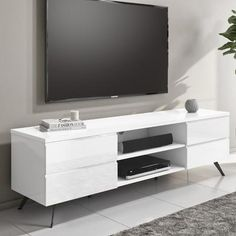 Discover our wide range of white tv units to add extra storage to your home. #livingroom #whitelivingroom #tvunit #tvstand #tvstands #glosstvunit #highglosstvunit #livingroomdecor #livingroomhome White Gloss Tv Unit, White Tv Unit, White Table Top, White Side Tables, Modern Tv Room, White Tv Stands, White Sideboard, Online Furniture, Living Room Decor