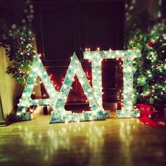Wrap christmas lights around your wooden letters. This would be cute for parties.