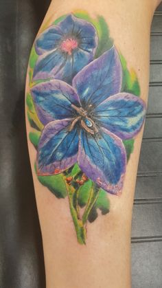 My tattoo to represent my daughter Rylee. It's her birth flower for July.