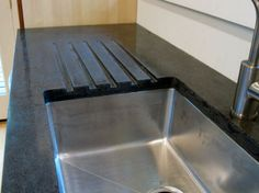 Black concrete countertop with recycled aggregate - Love the counter drainage(Nice for plants) & color shades.