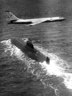 "Tu-16 overflying a Soviet ""Typhoon"" class ballistic missile submarine."