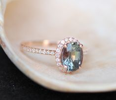Green blue sapphire engagement ring. Mint sapphire 1.39ct oval halo diamond  ring 14k Rose gold. by EidelPrecious on Etsy https://www.etsy.com/listing/235048235/green-blue-sapphire-engagement-ring-mint