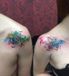 watercolor athom tattoo. matching tattoo