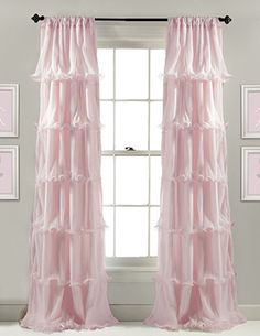 Sheer floor length pink ruffled curtains for a baby girl nursery