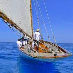 downwind sailing on a classic wooden boat
