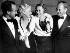 Recently married couples Harold Rosson & Jean Harlow and Sally Eilers & Harry Joe Brown attend a premiere at the Belasco Theater, Los Angeles. October, 1933