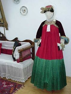 Skopelos Red gown The red dress was made from glossy and red cotton fabric and had a 55 cm high plain green satin hem. This was a formal dress and was even used as a wedding dress, mostly by girls from the poorer families. It was accompanied by the same accessories as the wedding dress.