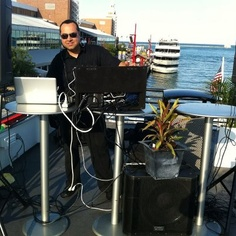 DJ Dave Mixing It Up on the rooftop of the Mystic Blue