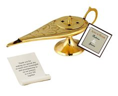 """Aladdin Genie Lamb Incense Holder Incense Holder Size: 7"""" L Scroll Size: 2.75""""W x 4.25""""H Have a magical Arabian Nights theme party with precision by enhancing your event with the brass incense lamp holder. The Aladdin Genie Lamp Incense Message Holder is the perfect ornament to enliven your whole house and have it smelling wonderfully. Just remove the top and fill up the incense holder with your favorite incent and enjoy the remainder of the night in peace.  This unique…"""