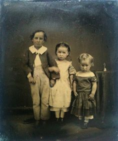 Increase the erie feeling in your home for halloween by hanging some creepy vintage photos in distressed frames.