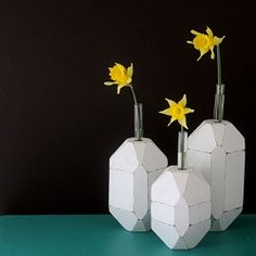 Simple 4x4 pieces and some test tubes can make an impact, thanks to a step by step tutorial on how to make the trendy faceted vase.