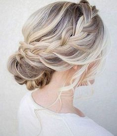 Elegant bridal bun with braid via Bride All