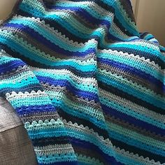 My take on this simple striped blanket - two rows dc, 2 rows granny stripe and repeat...