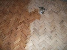 Compound Saw about to spring into action...       Flooring being glued down in Herringbone fashion...     Floor completely laid in Arth...