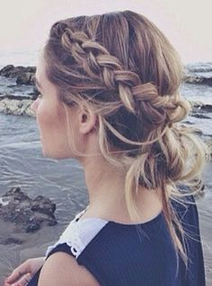 Braided (braid starts more on top of the head than directly from the front of the forehead)