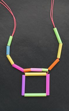 Square geometric shapes, neon colors drinking straw craft activities. Fun crafts for family, toddlers to teens, or as a classroom or homeschool art project. #craftactivity #drinkingstraws #diycrafts https://happythought.co.uk/craft/drinking-straw-necklace