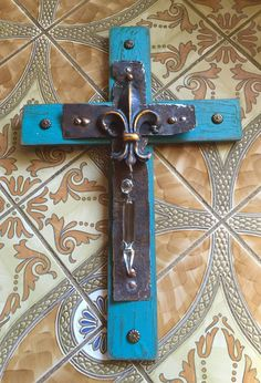 Cross made from old wood, tin and crystal fragments by Birmingham metal artist Catherine Partain Shamblin