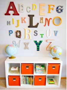 Ikea bookcase and orange bins. I know a TON of nurseries have this, but it's inexpensive and really practical!