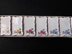 Here is a set of six vintage, Shafford, Japan, ceramic floral place card settings, holders. There are two with yellow flowers, two with blue flowers