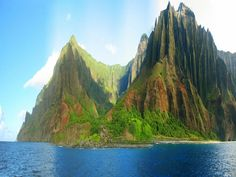 Na Pali Coast State Park along the northwest side of Kauaʻi, Hawaii. I will go there and I will drink a fruity drink.
