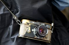 salvadorsanvicente:    Magnum photographer Bruce Davidson carries his well-worn Leica  Photo by Christophe Simon    Ever see a Canon 5d Mark II take this kind of a beating?