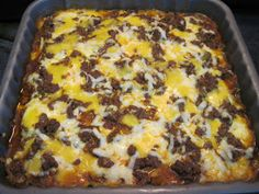 Cheese Enchilada Bake 1.5 lbs ground beef 2 tbsp chopped onion 2 tbsp chopped bell pepper 1 14 oz can enchilada sauce 1 8 oz pckg of cream cheese 1 egg 1 1/2 tsp garlic powder 1 tsp onion powder 1 tsp cumin 1 tsp chili powder 1 1/2 cup cheese shredded