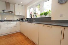 White L-shaped kitchen