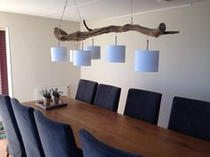 Ceiling lamp made of weathered old oak branch. 6 lights in white or gray shades. Total length of the trunk is 202 cm. in connection with