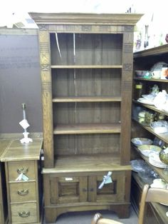 $229 - This unique Oak cabinet is made completely from reclaimed wood. Carving around the top and front as well as the oak crown add to the charm. The base has double opening doors for hidden storage. The cabinet measures 35 inches across the front, 18 inches deep and it stands 77 inches tall. It can be seen in Booth A6 at Main Street Antique Mall 7260 East Main St ( E of Power Rd ) Mesa 85207  (contact info hidden) open 7 days 10 till 530  Cash or charge 30 day layaway also av...