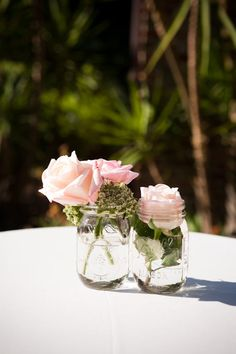 Totally! Mason jars and flowers! Wedding reception table center peices