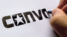 Mesmerizing: Calligrapher draws perfect corporate logos completely freehand.