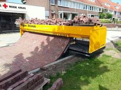 Brick path laying machine.