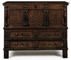 """A JOINED AND PAINTED OAK CARVED """"SUNFLOWER"""" CHEST WITH TWO DRAWERS   POSSIBLY THE PETER BLIN (CIRCA 1640-1725) SHOP TRADITION, WETHERSFIELD AREA, CONNECTICUT, 1675-1710  38¾ in. high, 48 in. wide, 21 in. deep"""