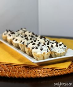 Chocolate Chip Cannoli Cups - these little cups are overflowing with sweet, creamy marscapone and ricotta cannoli filling packed with chocolate chips and nestled in flaky phyllo cups. These only take 10 minutes to make and are just 63 calories or 3 Weight Watchers SmartPoints each! www.emilybites.com